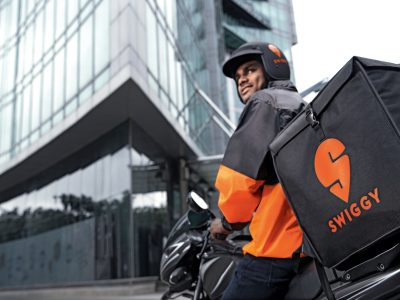 Swiggy deliver boy appears in the foreground